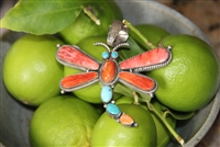 American made from New Mexico. A silver  and Spiny Oyster Dragon Fly pendent with turquoise accents.