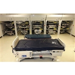 High Capacity Bed Stackers lifts and stacks beds storing multiple hospital beds vertically in the footprint of a single bed to reduce corridor clutter and improve egress, for broken beds waiting repairs and maintenance by Biomedical Engineering
