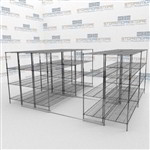 Movable Wire Shelves on Floor Tracks Consolidating Storage Footprint