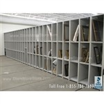 Artwork rack storage displays storing framed paintings, sculptures and exhibits.
