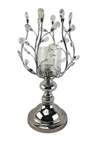 This fabulous D'Lusso Designs Silver Metal Candle Holder makes the perfect gift to impress. Made of intricately designed metal and hand made ornaments, it is surely a gift or centerpiece that will be treasured. Measures: 10x10x19
