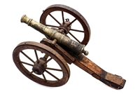Vintage miniature brass cannon with a wood carriage