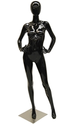 Glossy Black Female Mannequin with her hands on her hips. She has an abstract egghead.