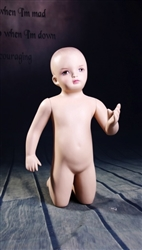 Toddler in kneeling pose. Unisex toddler with realistic facial features.