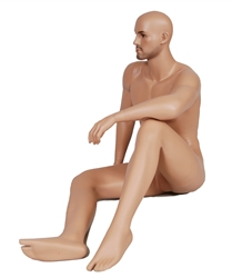 Male mannequin with realistic facial features in seated pose.
