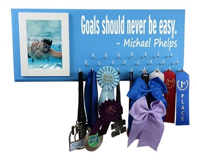 Swimming ribbons display - SWIMMIMG on the wall