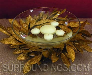 Bay leaf wreath with round floating candles and glass centerpiece bowl