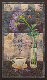 Quilt block of a steaming cup of coffee next to a vase to flowers.