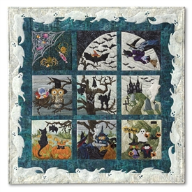Full Halloweenies quilt shows witches, bats, birds, spiders, little monsters, and spooky trees celebrating the best night of the year underneath a full moon. Laser Kits.