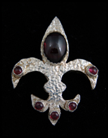 Fleur de Lys silver and Garnet Broach