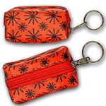 Lenticular purse key chain with red spinning wheels on white background, animation