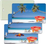 Lenticular luggage tag with  palm trees, umbrella, and lawn chair appear on a tropical Hawaiian beach, flip