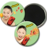 Lenticular magnetic button with smiling Snapple girl holding a drink, flip
