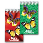 Lenticular mini notebook with large yellow butterflies, background switches from green to red, flip
