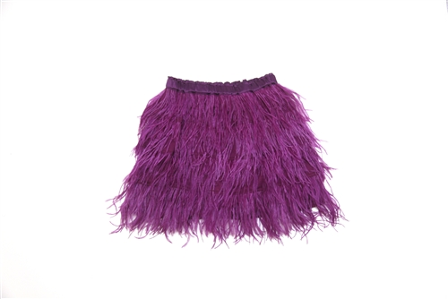 curio+kind's feather skirt in berry.  Hand sewn feathers adorn this skirt creating a light, airy look & feel.