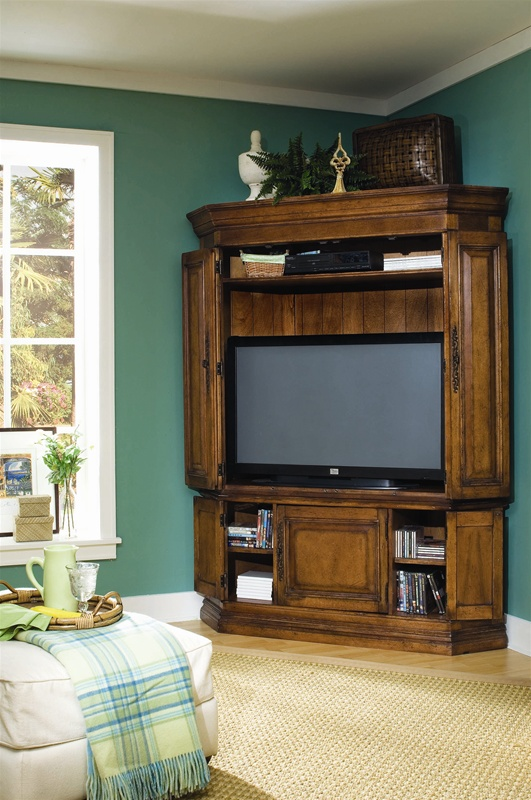 Summit ridge corner entertainment center in medium antique for Corner home theater furniture