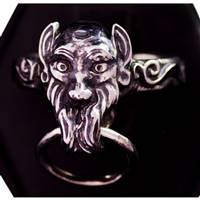 Goblin slave ring in tarnish resistant sterling silver.