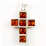 This is a lovely Modern Art interpretation of the classic cross. The cast Sterling Silver Cross is set with square Dark Honey Amber stones creating a stained glass window effect........and the other side is set in Dark Olive stones.