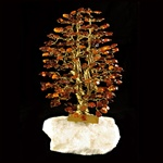 "The leaves of this bonsai style tree are made with real polished amber stones attached to branches and trunk of twisted brass wire.  The tree sits atop a piece of the finest Polish marble called ""Marianna""."