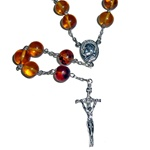 A legend from the Polish region of Kurpie has it that amber is human tears from the times of the forty-day rain.  A gift of Amber is even more special. It is a gift of sunlight, life, and love.  These pure amber rosary beads are larger than average, and m