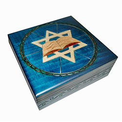 This beautiful box is made of seasoned Linden wood, from the Tatra Mountain region of Poland.  The top is adorned with the six-sided Star-of-David and the Torah.  The outside area and sides of the box are a deep blue color.  Note: the last photo is closer