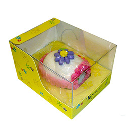 Medium sugar panoramic Easter Egg with a miniature sugar Easter chick sitting on green sugar grass inside.   Floral design on the outside, surrounded by a decorative band of colored icing.