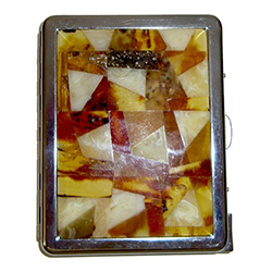 Unique and beautifully hand-crafted cigarette case with built-in cigarette lighter.  Both front and back panels are decorated in beveled highly-polished multi-colored shades of honey, cream and green amber, surrounded by brilliant chrome-plated brass.