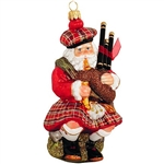 "This Scottish Santa wishes you and yours a very Nollaig Chridheil! Artfully crafted of glass from Poland and painted plaid with glittering accents, this 5½"" tall ornament will add a touch of Scotland's enchanting charm t"