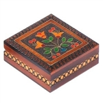 Inlaid Floral Box. This box features a brightly colored floral design accented with metal inlay and set against a carved, burned texture background.