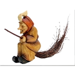 Our Polish Forest Witch is riding on a really willow broom.  She can be displayed sitting on a table or hung from the accompanying leather strap.  Nicely carved and stained.  Broom is in two pieces and inserted into the body of the witch.