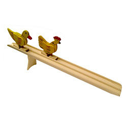 This is a very old and traditional folk racing game.  The race is based on a simple set of ideas....a wooden incline, gravity and two wooden figures.  Set the chicken and the duck at the top of the ramp, let them go at the same time and watch which one re