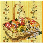 Basket full of Pisanki Dinner Napkins (package of 20).   Three ply napkins with water based paints used in the printing process.  The basket of Pisanki pattern appears on the front of this napkin and the daisies are on the other 3 sides.