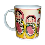 This attractive ceramic mug features a set of Russian Matrushka dolls.