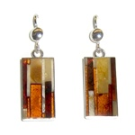 Beautiful set of dangle earrings, consisting of a mosaic of amber stones set in silver with a French hook attachment.  No two are exactly alike.