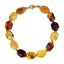 Nicely faceted amber stones on a knotted cord.
