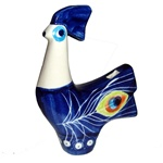 Collectors of Polish stoneware will enjoy this unique item.  This is a folk whistle with three holes: one to blow into and one for the air to exit and one to modulate the whistle tone.  You blow into the tail hole and move your finger over the breast hole
