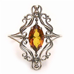 Victorian-style marquis-cut clear amber stone mounted in sterling silver, to make a gorgeous cuff bracelet.  The high-quality clear amber stone is without inclusions or internal flaws, and its beauty is set off with the detailed silver filigree work that