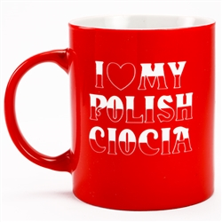 This attractive glass mug is decorated in the colors of the Polish flag, red and white.