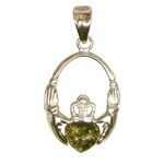 This is a very pretty Irish Claddagh style Pendant with a green Amber heart.