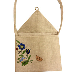 Handmade linen purse with an extra long shoulder strap embroidered with a traditional Kashubian floral design.