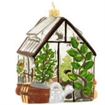 "For garden enthusiasts, our charming 3-dimensional green house ornament is sure to grow into a beautiful addition to your holiday decorations!  Exquisitely designed in glass with colorful accents of silver, copper and green glitter, our 4"" tall green hous"