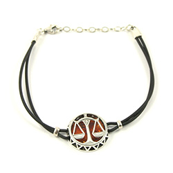 Sterling Silver and Baltic amber Libra zodiac sign charm on a durable cord made of black rubber.