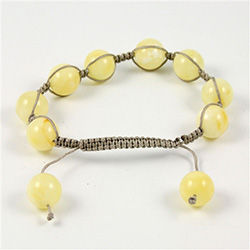 This fine macrame bracelet is made with light custard colored amber.  This bracelet includes a grey cord and a slide clasp to fit most wrists.