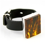 "Large block of clear honey amber (1.25"" x 1.5"" - 3cm x 4cm) with a dark striped background and set in sterling silver with an adjustable belt bracelet (6.25"" - 8.5"" - 16cm - 22cm long)."