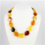 This beaded Amber necklace features shades of yellow, honey, green, and cherry Amber. The beads are hexagonal and slightly faceted.  We have several in stock so the arrangement of the beads will vary from the picture.