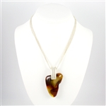 Stunning Amber pendant on brushed sterling silver chain. The amber cabochon is polished on the front side and partially polished on the back to highlight its natural state.
