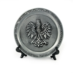 Nicely decorated plate with a pewter finish featuring the Polish Eagle and the word Poland in six languages around the rim.