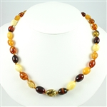 "Natural Baltic Amber Cherry, Custard, Light and Dark Honey Amber Oval Amber Bead size  1/2"" long by 3/8"" wide bronze colored cord w/ knot between each bead. SIlver claw clasp closure."
