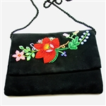 "Hand embroidered shoulder purse made from felt and velvet.  Fully lined.  Extra long strap (extends to 30""). Snap closure.  Made in Lowicz, Poland.  Flower colors and design vary slightly from purse to purse."
