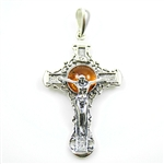 The cast antique style Sterling Silver Cross has a center of golden amber.